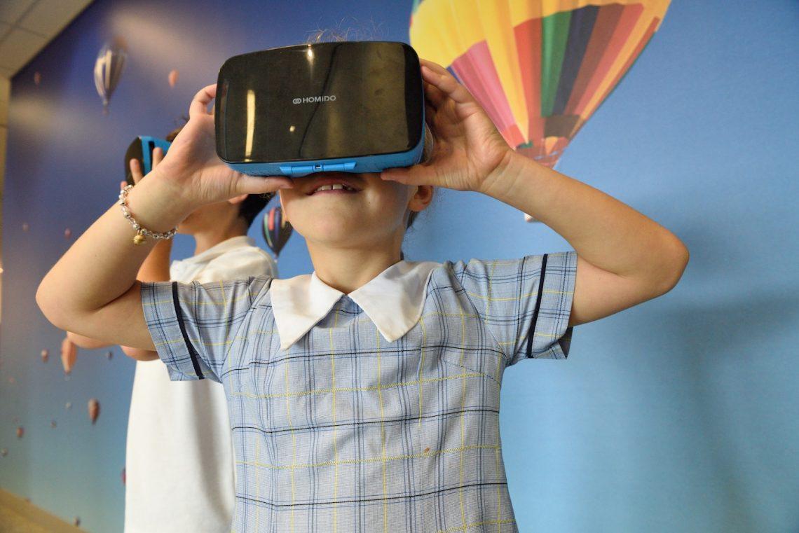little girl using virtual reality headset